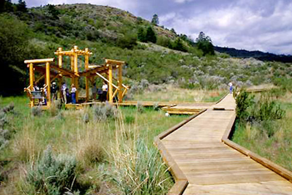 People standing on a walkway at the Osoyoos Desert Centre near Walnut Beach Resort.