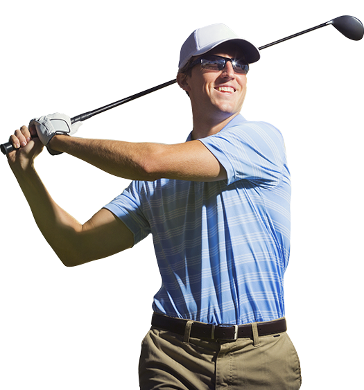 Man with a smile swinging a golf club.