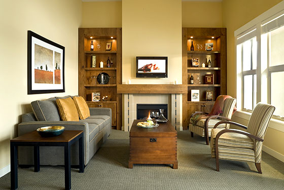 Penthouse living room with a fireplace at Walnut Beach Resort.