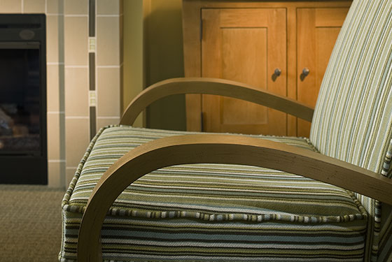 Close up of a comfy chair in a guest room at Walnut Beach Resort.