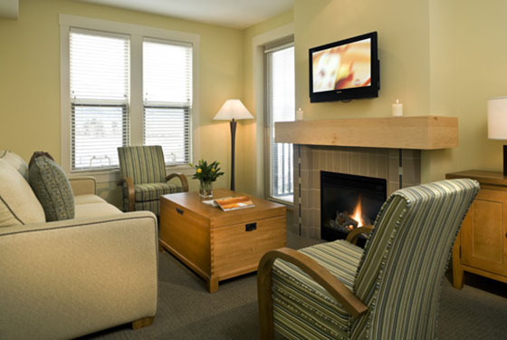One bedroom suite living room with a fireplace at Walnut Beach Resort.