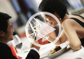 Video still image of a couple dining together.