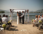 Bride and groom getting married on the private beach at Walnut Beach Resort.